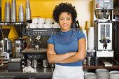 Woman standing beside espresso machine