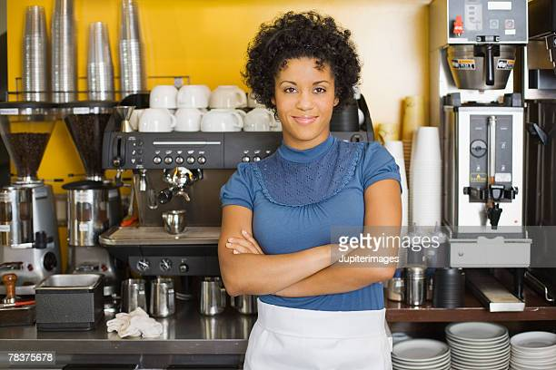 Woman standing beside espresso machine