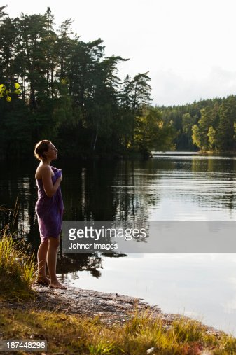 Woman standing by lake : Stock Photo