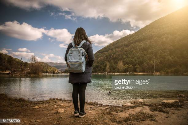 woman standing by lake