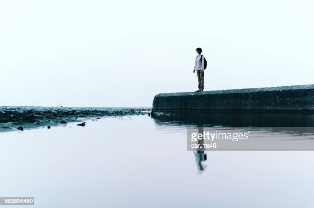 Woman Standing by Ocean