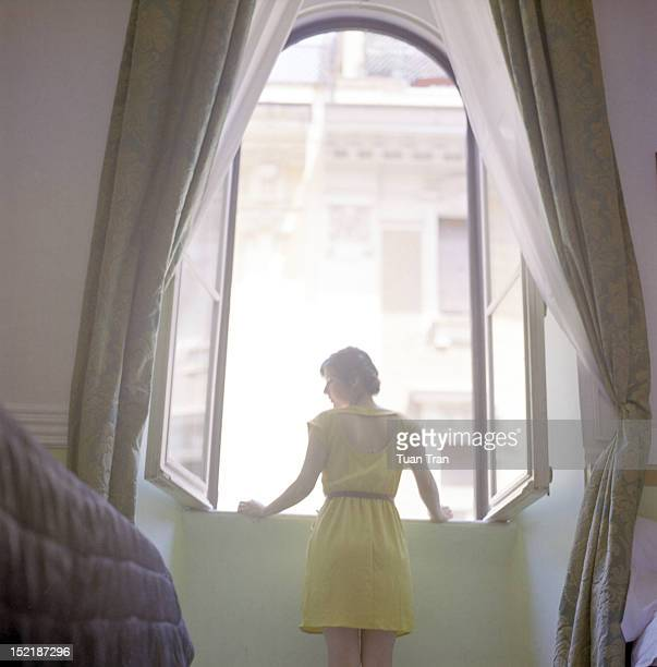 Woman standing by window