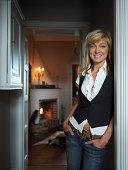 Woman standing in a doorway, Malmo, Skane, Sweden.