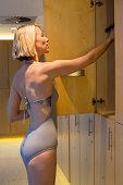 Woman standing in a locker room