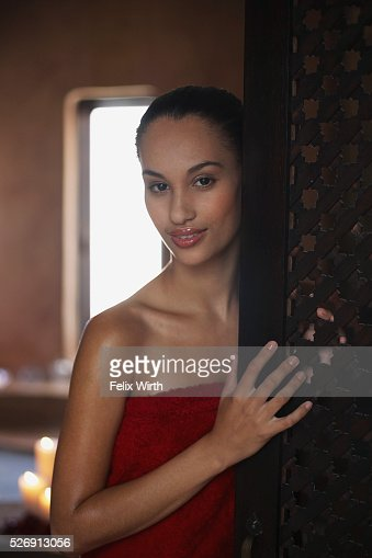 Woman standing in bathroom : Stock Photo