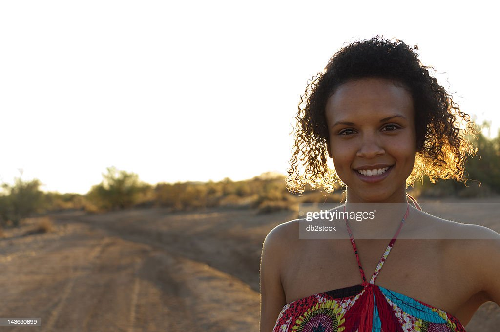 Woman standing in desert landscape : Stock Photo