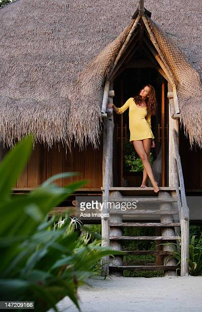 woman standing in doorway of tropical home
