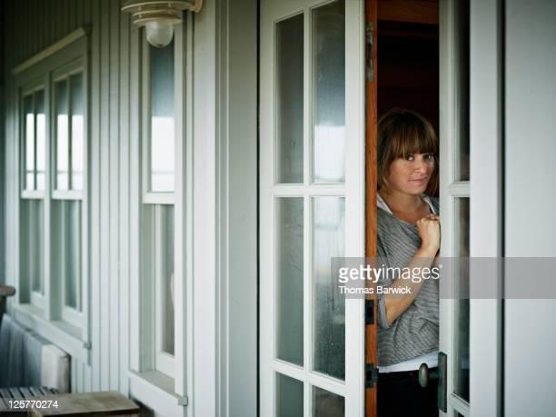 Woman standing in doorway of vacation home