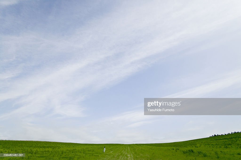 Woman standing in field : Stock Photo