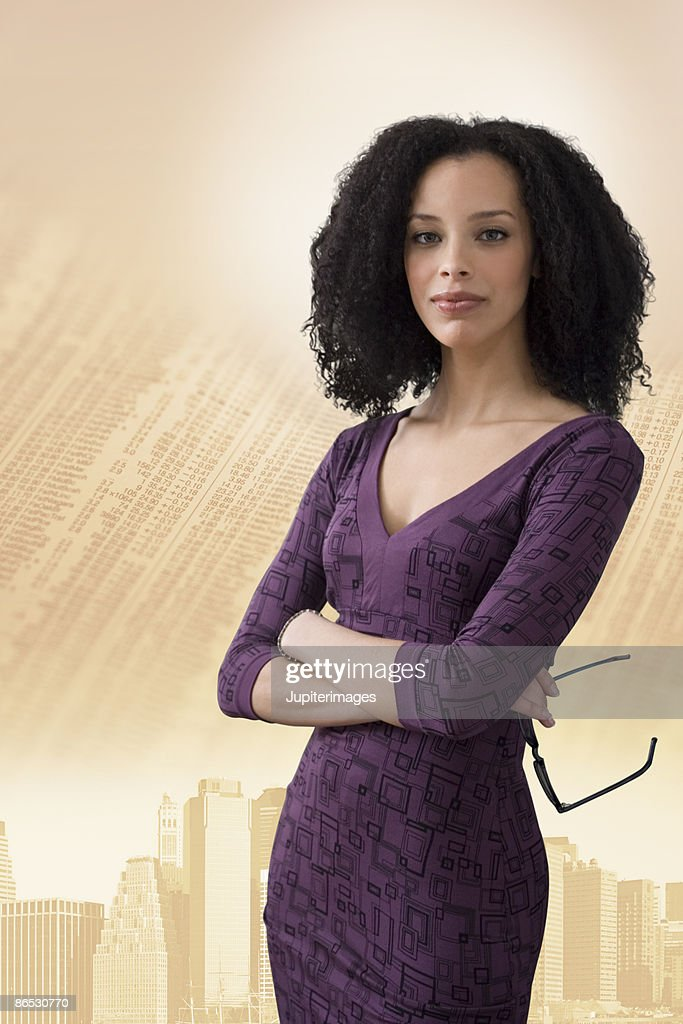 Woman standing in front of city skyline and newspaper