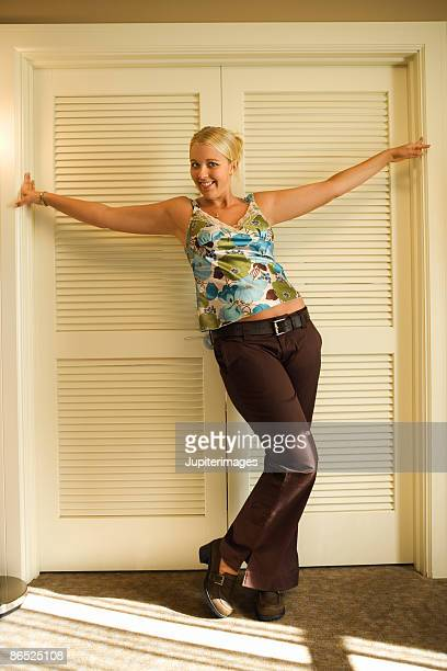 Woman standing in front of louvered doors