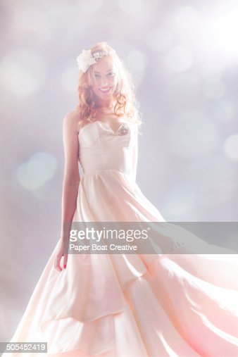 Woman standing in her long wedding dress
