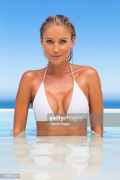 Woman standing in infinity pool