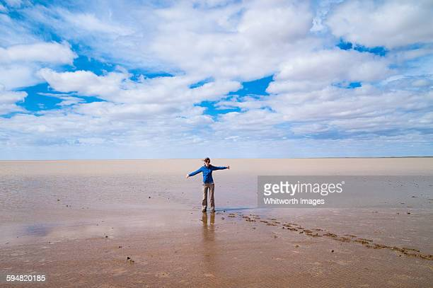 Woman standing in lake Eyre, outback Australia
