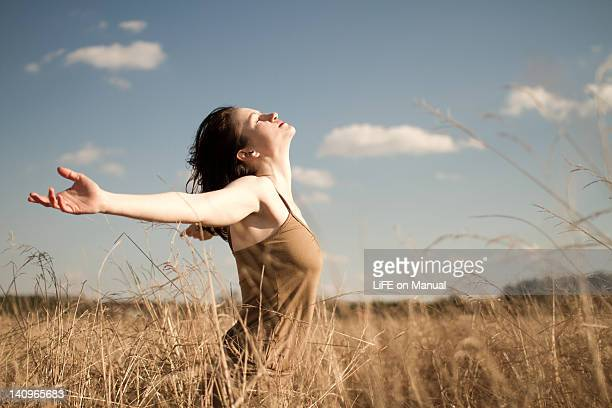 Woman standing in long grass