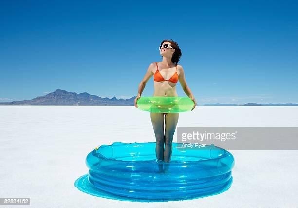 Woman Standing in Pool in Desert