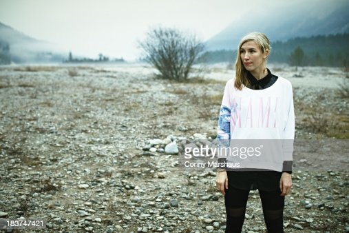 Woman standing in remote setting : Stock Photo