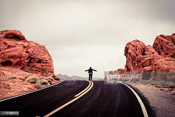 Woman standing in road