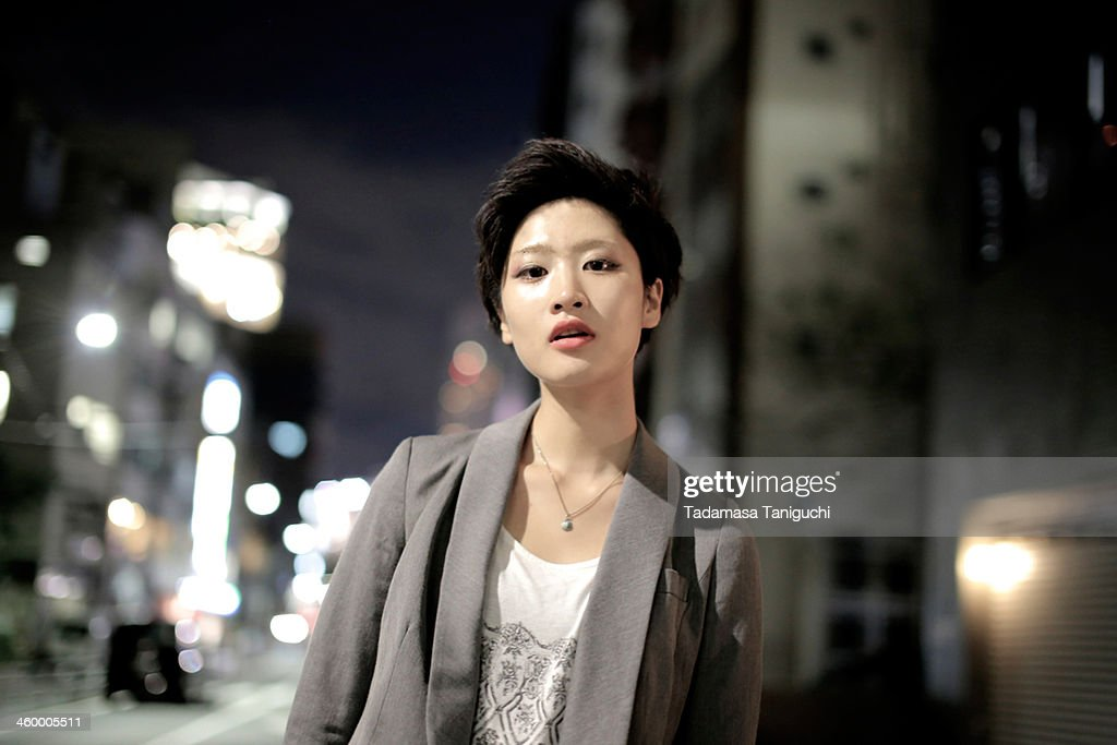 Woman standing in the city at night : Stock Photo