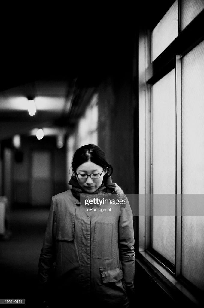 Woman standing in the dark : Stock Photo