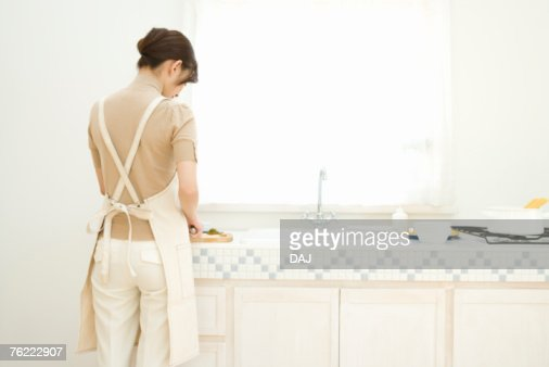 A Woman Standing In The Kitchen Rear View Stock Photo | Getty Images