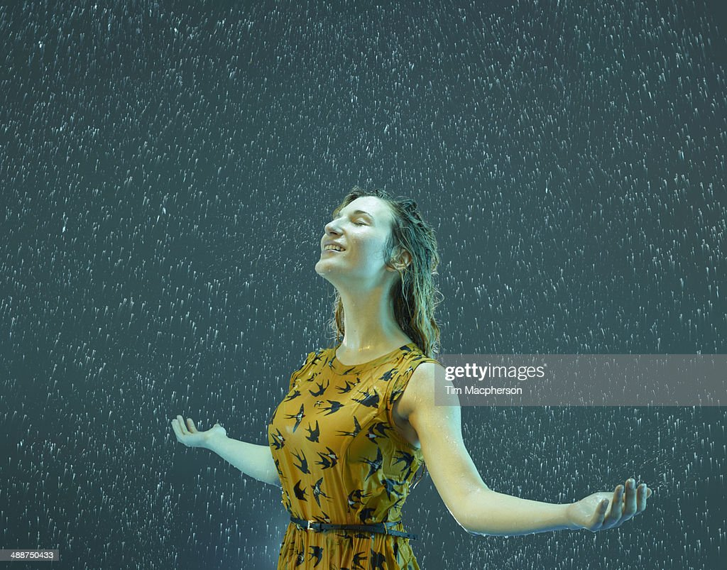 A woman standing in the rain