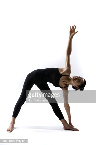 Woman standing in triangle pose