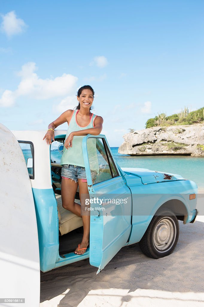 Woman standing in truck and smiling : Stock Photo