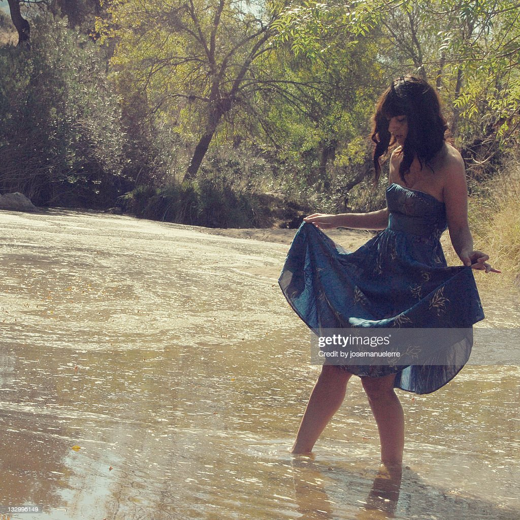 Woman standing in water : Stock Photo