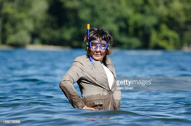 Woman standing in water with her nice clothes