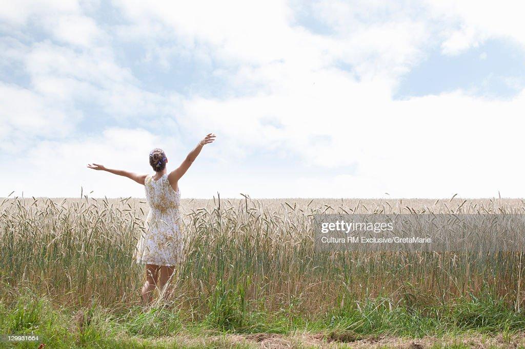 Woman standing in wheatfield : Stock Photo