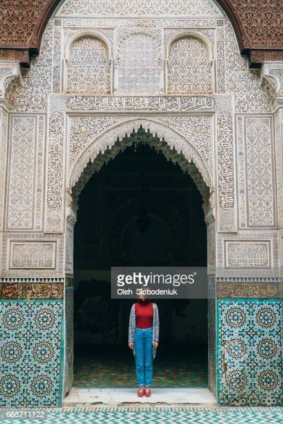 Woman standing inside riad in Morocco