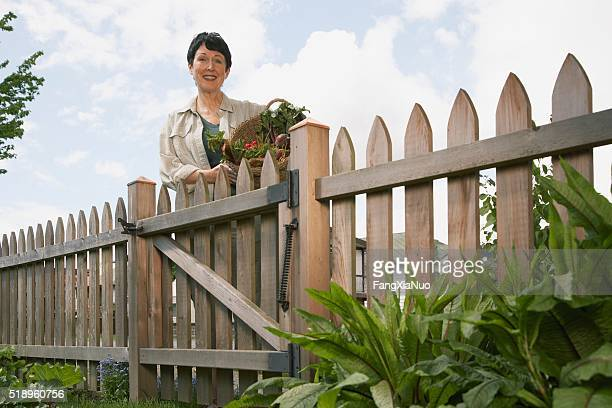 Woman standing near gate