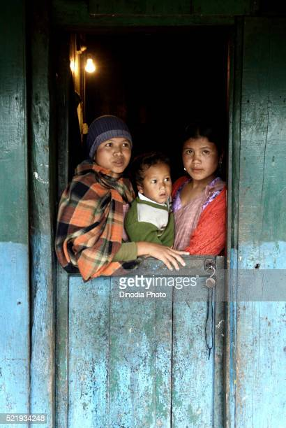Woman Standing Near Window with Children The Khasi Tribe Shillong Meghalaya India