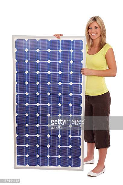 Woman Standing Next To Solar Panel