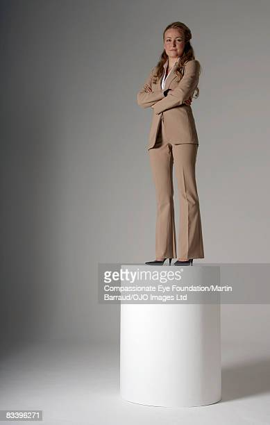 Woman standing on a pedestal
