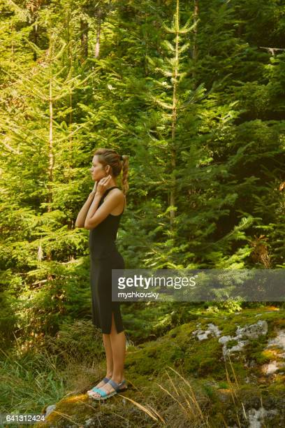 Woman standing on a rock in the forest