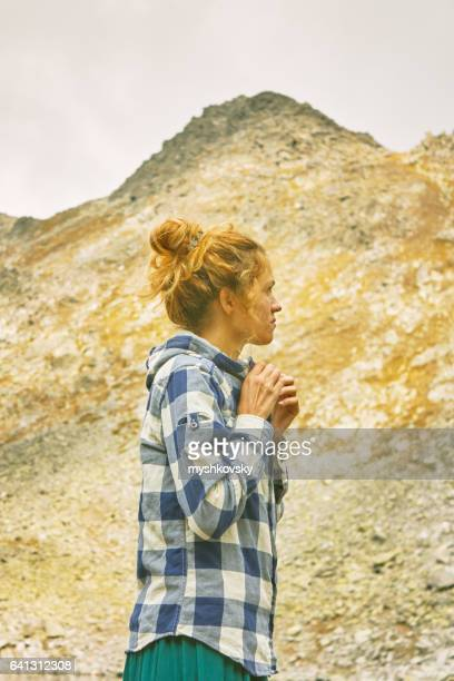 Woman standing on a rock in the Rila mountains