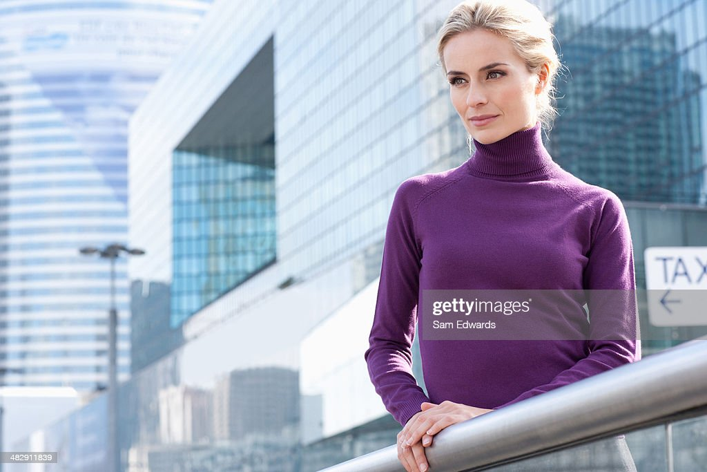 Woman standing on balcony outdoors