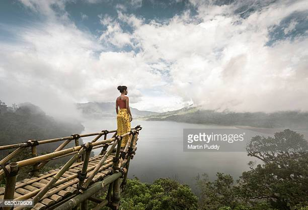 woman standing on bamboo viewing platform