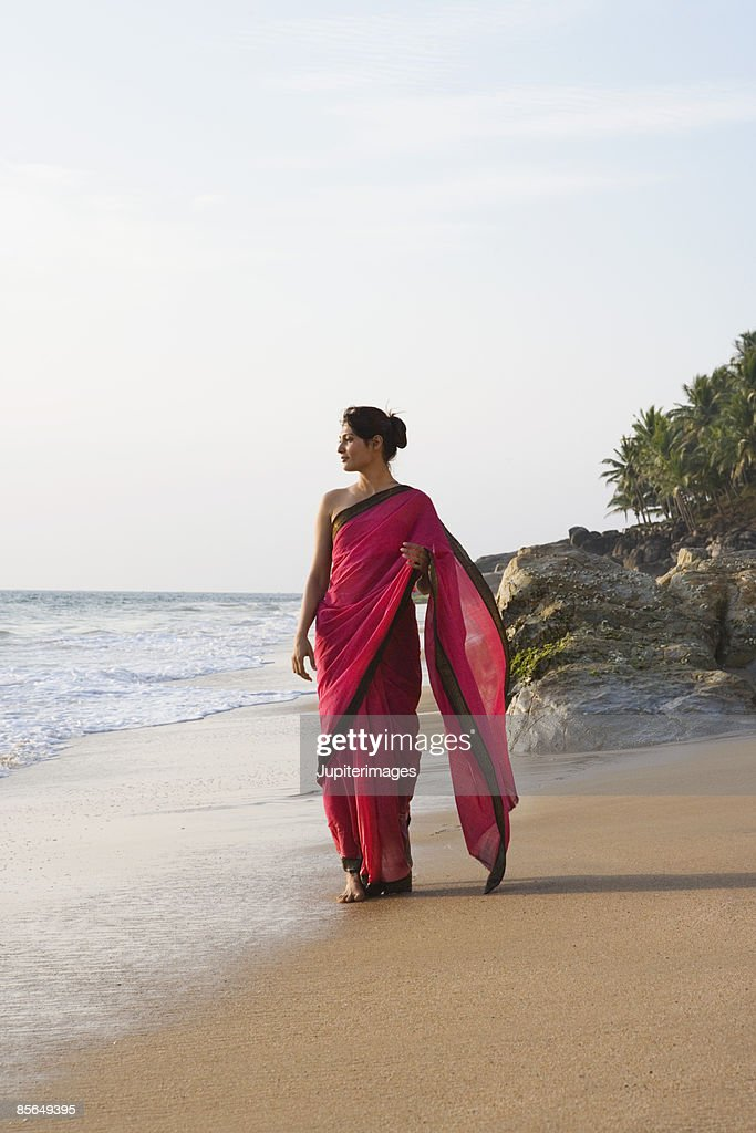 Woman standing on beach, India