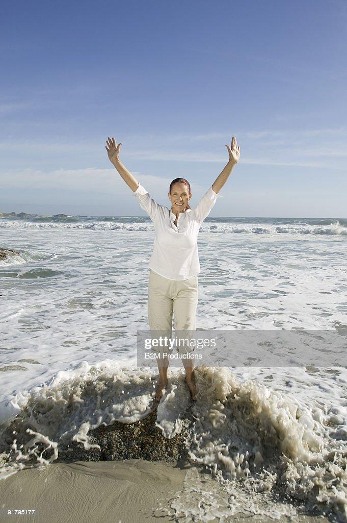 Woman standing on beach : Stock Photo