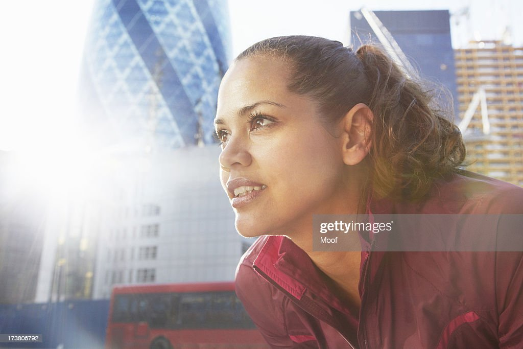 Woman standing on city street : Stock Photo