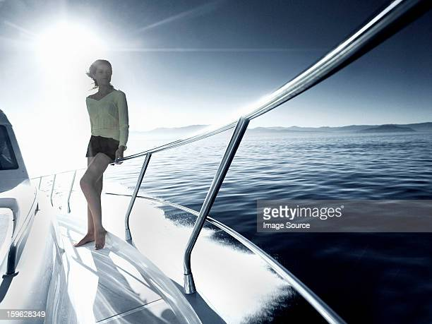 Woman standing on deck of yacht