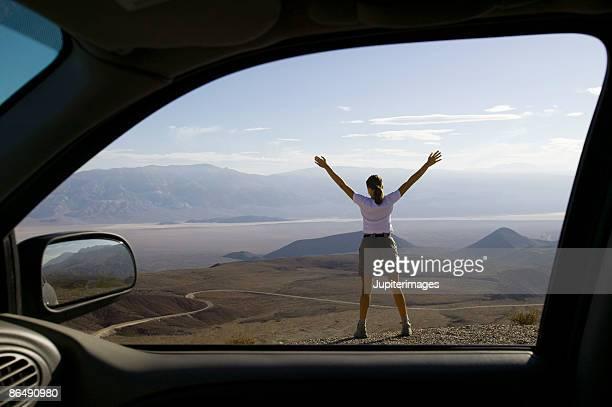 Woman standing on desert overlook
