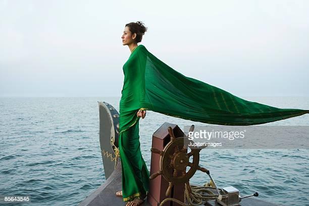 Woman standing on houseboat, India