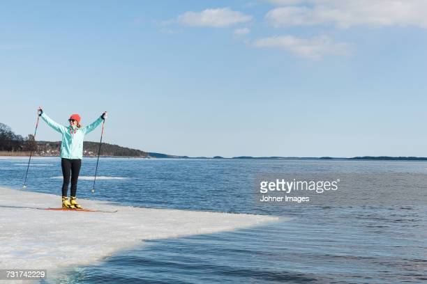 Woman standing on ice floe