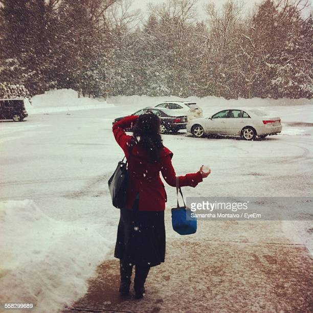 Woman Standing On Parking Lot In Winter