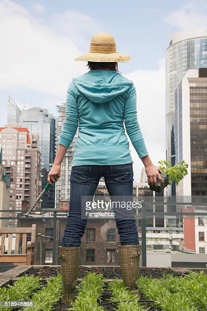 Woman standing on roof garden