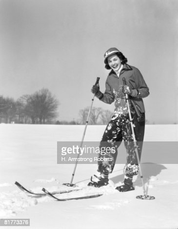 Woman Standing On Skis Smiling At Camera Ski Clothes Smiling Laughing Spattered With Snow From Fall. : Stock Photo